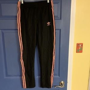 Peachy pink colored button adidas track pants